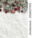 snow fir christmas tree branch | Shutterstock . vector #1028327935