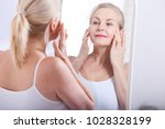 middle aged woman looking at... | Shutterstock . vector #1028328199