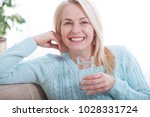 beautiful middle aged woman... | Shutterstock . vector #1028331724