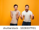 portrait of a two satisfied... | Shutterstock . vector #1028337931