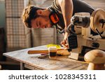 Small photo of Wood boring drill in hand drilling hole in wooden bar
