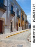 typical colonial street in... | Shutterstock . vector #1028356369