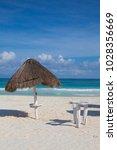 on the empty beach in playa del ... | Shutterstock . vector #1028356669