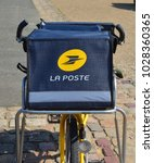 Small photo of LE MANS, FRANCE - AUGUST 31, 2017: Yellow bicycle of a post office La Poste of French city