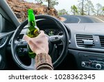 drunk young man driving a car... | Shutterstock . vector #1028362345