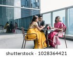 three indian business people... | Shutterstock . vector #1028364421