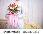 wedding flowers  woman holding...   Shutterstock . vector #1028370811