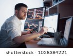 stockbroker in shirt is working ... | Shutterstock . vector #1028384221