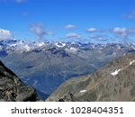 view over the alps above the... | Shutterstock . vector #1028404351