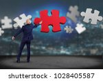 view of a businessman in front...   Shutterstock . vector #1028405587