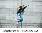 cheerful young woman dressed in ... | Shutterstock . vector #1028422765