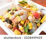 spicy papaya corn salad with... | Shutterstock . vector #1028449435