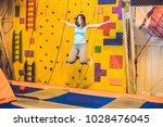 young woman sportsman jumping...   Shutterstock . vector #1028476045