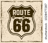 route 66 road sign with bullet... | Shutterstock .eps vector #1028477287