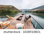 tourist boats  vineyards and... | Shutterstock . vector #1028510821
