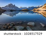 mont blanc massif reflected in... | Shutterstock . vector #1028517529