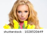 beautiful blonde girl in pink... | Shutterstock . vector #1028520649