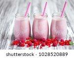 three jars of pink berry... | Shutterstock . vector #1028520889