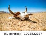 cow skull into the desert.... | Shutterstock . vector #1028522137