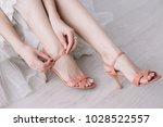 beautiful woman legs in pink...   Shutterstock . vector #1028522557