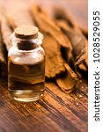cinnamon essential oil   Shutterstock . vector #1028529055