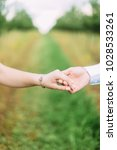loving couple on a walk in the... | Shutterstock . vector #1028533261