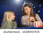 cheerful mother and daughter... | Shutterstock . vector #1028541925