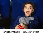 joyful cute little hispanic boy ... | Shutterstock . vector #1028541985