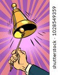 hand ringing the bell. comic... | Shutterstock .eps vector #1028549359
