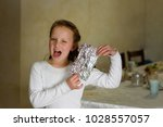 girl found it  afikoman is a... | Shutterstock . vector #1028557057