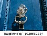 old blue door with knocker | Shutterstock . vector #1028582389