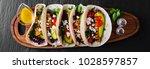 mexican tacos with avocado ... | Shutterstock . vector #1028597857