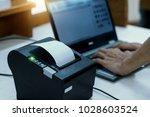 cashier are recording sales... | Shutterstock . vector #1028603524