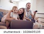 portrait of a joyful family... | Shutterstock . vector #1028605135
