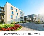 complex of modern apartment... | Shutterstock . vector #1028607991