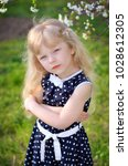 Small photo of a girl in a dress sits on fresh air spring