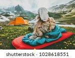 woman relaxing in sleeping bag... | Shutterstock . vector #1028618551
