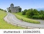 a bicyclist near castle in... | Shutterstock . vector #1028620051