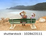 people on the bench near the... | Shutterstock . vector #1028623111