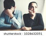 young sad couple arguing in home | Shutterstock . vector #1028632051