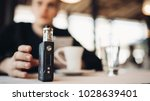 using electronic cigarette to... | Shutterstock . vector #1028639401