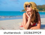 woman in sun hat and swimsuit... | Shutterstock . vector #1028639929
