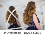 wedding hairstyle  rear view   Shutterstock . vector #1028651839