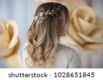wedding hairstyle  rear view   Shutterstock . vector #1028651845