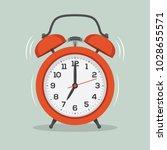 red old ringing alarm clock...   Shutterstock .eps vector #1028655571