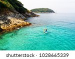 strong men floating on a sup... | Shutterstock . vector #1028665339