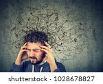 thoughtful stressed young man... | Shutterstock . vector #1028678827