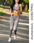 young fitness woman running... | Shutterstock . vector #1028679901