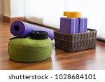 various yoga props on studio... | Shutterstock . vector #1028684101