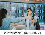 happy asian woman giving warm... | Shutterstock . vector #1028688271